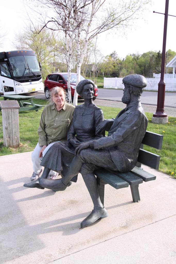 Mom with a statue of Alexander Graham Bell and his wife.